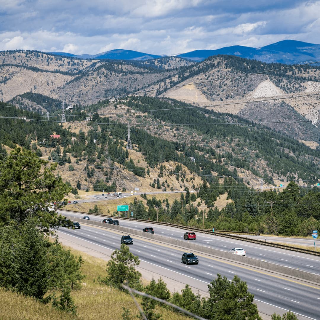 photo of various cars on I-70 near the mountains